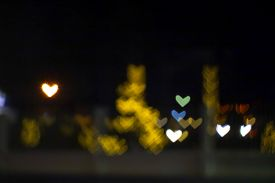 Yellow Bokeh And Blur Heart Shape Love Valentine Day Colorful Night Light On Street