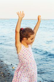 Cute Little Girl Spending Time At The Seaside.  Summer  Day, Happy Childhood, Ocean Coast Concept