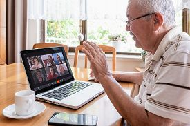 Antalya, Turkey - May 27, 2020. Old Man Having Zoom Video Conferencing Call With His Family Via Comp