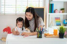 Asian Kindergarten Student Girl With Mother Painting Picture In Book With Color Pencil At Home, Home