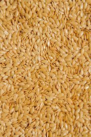 Close Up.  Dry Raw Seeds Gold Colour Linseed, Flax Seeds Pattern Background Or Texture.