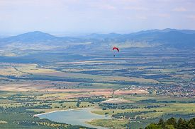 Paragliding From Dobrostan In Bulgaria Above The Lake