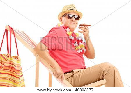 Gentleman smoking a cigar and enjoying on a sun lounger, isolated on white background