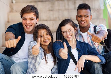 group smiling high school students giving thumbs up