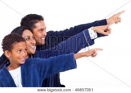 happy indian family in nightclothes pointing empty copy space on white background