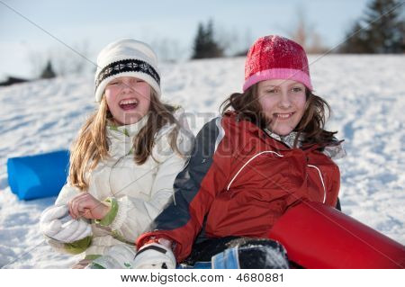 Girls Playing On Hill