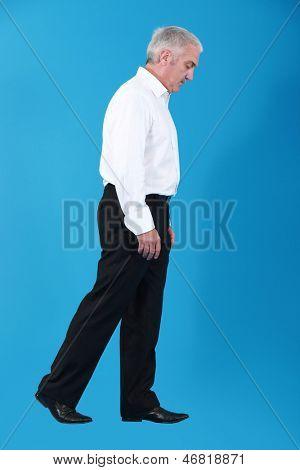 Businessman walking an imaginary tightrope