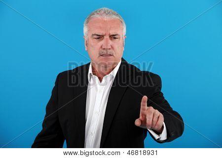 Elderly man reprimnading