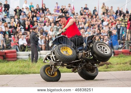 MOSCOW - AUG 25: Man stunt shows on a quad bike on Festival of art and film stunt Prometheus in Tushino on August 25, 2012 in Moscow, Russia. The festival was organized in 1998.