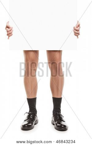 Naked adult man in black socks and shoes hand holding blank placard white isolated