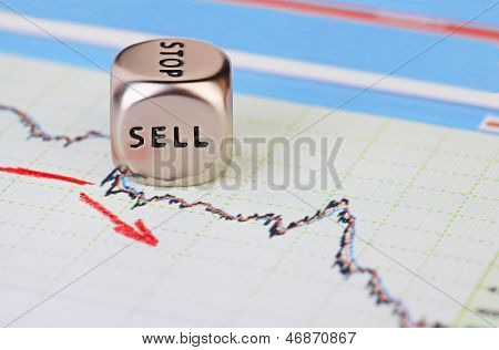 Downtrend Financial Market Chart With Red Arrow And Dices Cube With The Word Sell. Selective Focus