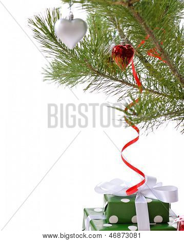 green  gift boxes under Christmas tree