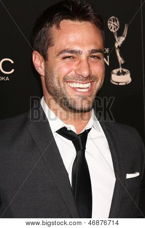 LOS ANGELES - JUN 16:  Marco Dapper arrives at the 40th Daytime Emmy Awards at the Skirball Cultural Center on June 16, 2013 in Los Angeles, CA