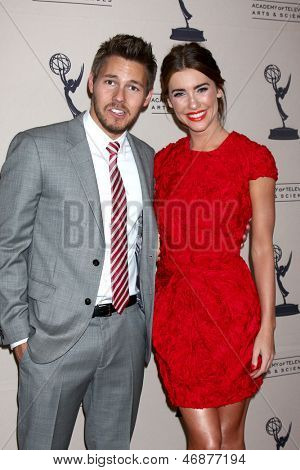 LOS ANGELES - JUN 13:  Scott Clifton, Jacqueline MacInnes Wood arrives at the Daytime Emmy Nominees Reception presented by ATAS at the Montage Beverly Hills on June 13, 2013 in Beverly Hills, CA