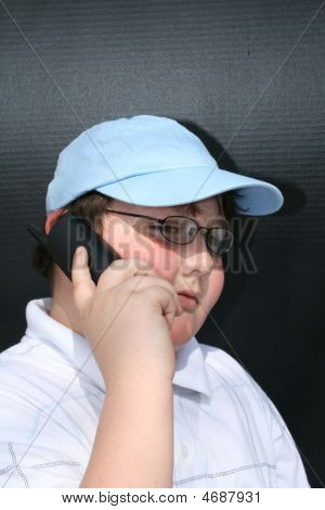 Young Boy Talking On The Telephone
