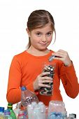 Girl recycling batteries poster