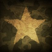 Military camouflage background with grunge star. poster