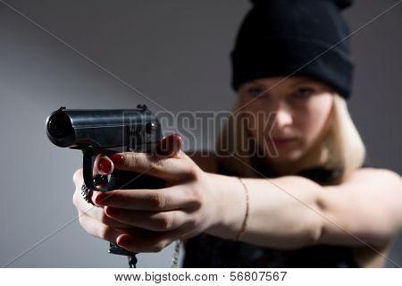 Portrait Of A Young Girl With A Gun In His Hand