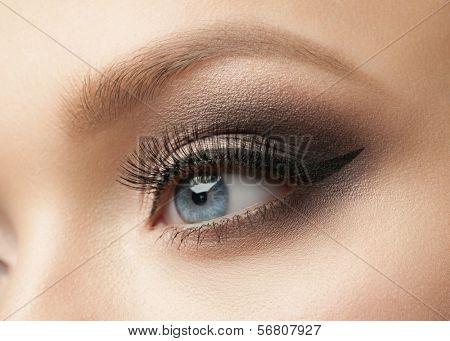 Closeup of beautiful woman eye with makeup, eyeliner