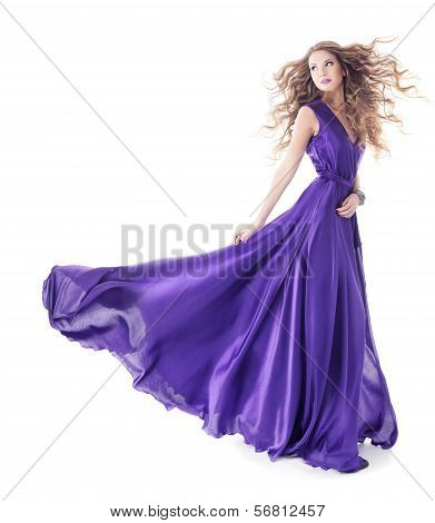 Woman In Purple Silk Waving Dress Walking Over Isolated White Background