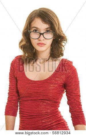 Pretty teen brunette girl in red dress with eyeglasses