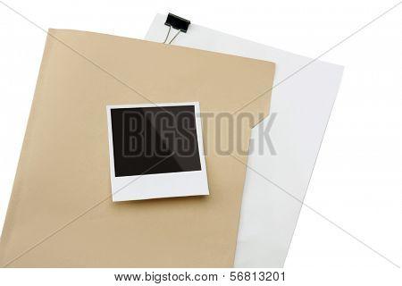Blank instant print clipped to manila folder
