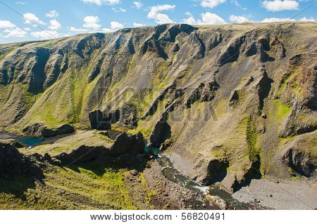 Canyon with a river near the Fagrifoss waterfall. It is located on the South of Iceland not far from the volcano Laki