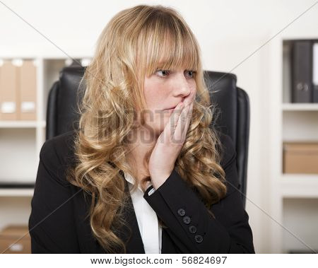 Young Businesswoman Looking Worried