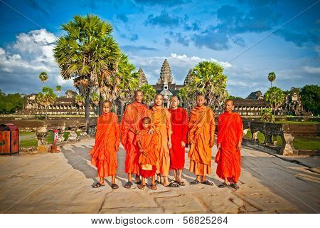 ANGKOR WAT, CAMBODIA - NOV 20,2013 - Unidentified Buddhist monks in Angkor Wat complex on Nov 20, 2013.Cambodia. Angkor Wat was first a Hindu, then subsequently, a Buddhist temple complex in Cambodia.