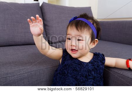 Baby girl waving hand