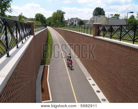 Father and son riding bikes on the Monon Greenway Trail in Carmel, Indiana. poster