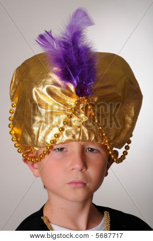 Young boy wearing a Sultan or Shiek's halloween costume poster