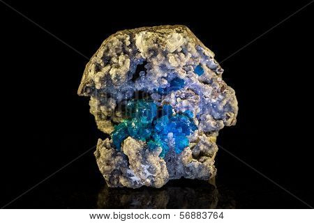 Cavansite Mineral Stone In Front Of Black