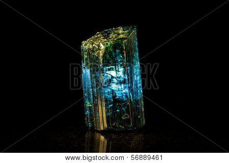 Indigolite mineral stone, black background