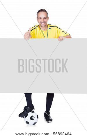 Portrait Of Happy Coach Holding Placard And Football Isolated On White Background poster