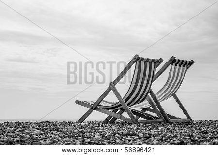 Black And White Deck Chairs On Brighton Beach, England