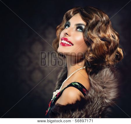 Retro Woman Portrait. Smiling Luxury Lady. Beautiful Woman. Vintage Styled Photo. Old Fashioned Makeup and Finger Wave Hairstyle. 20's or 30's style.