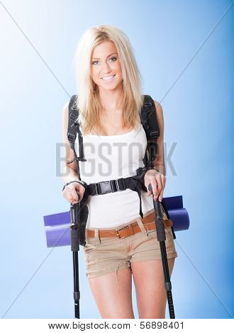 Young Woman With Backpack And Jogging Sticks