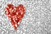 An abstract silver glitter red heart background poster