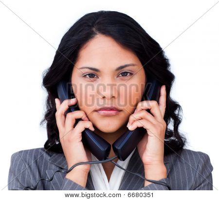 Annoyed Businesswoman Tangled Up In Phone Wires