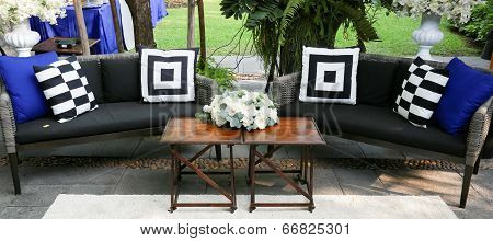 Outdoor Sofa Decorated With White Roses