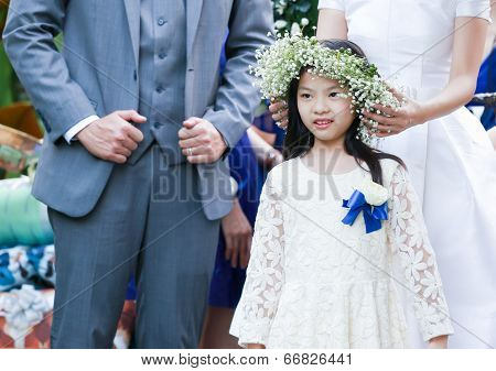Cute Little Flower Girl In The Wedding Ceremony