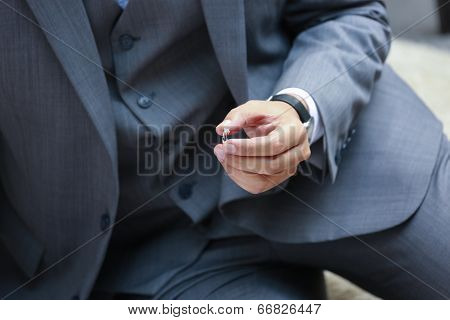 Wedding Ring Is Prepared For The Bride In The Groom's Hand