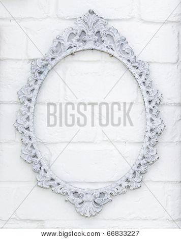 Vintage Picture Frame On White Brick Wall Background