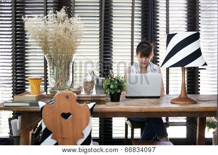 Young Asian Working Woman Is Using A Laptop With Vintage Decoration