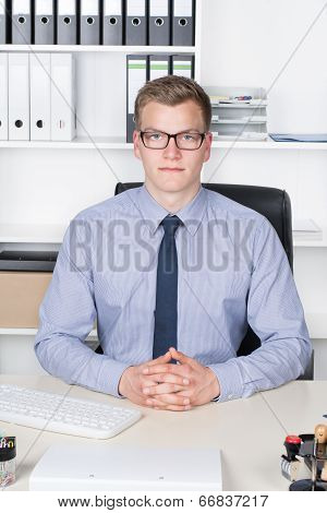 Young Businessman Is Sitting Relaxed At The Desk