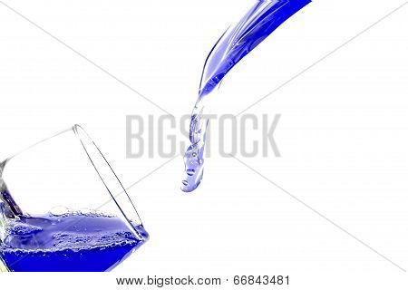 Filling glass with blue fluid