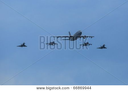 BERLIN, GERMANY - MAY 21, 2014: An Airbus A310-304 is used as a tanker and fly 2 Tornado in refueling position, 2 outside flying Eurofighter are in waiting position, demonstration at ILA Air Show.