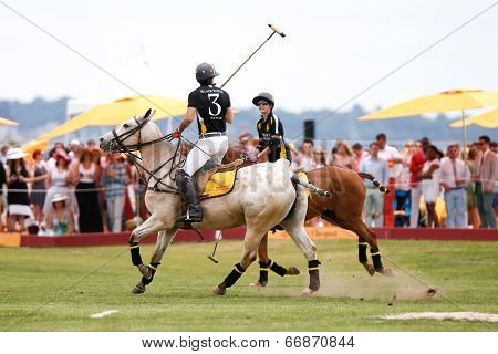 JERSEY CITY, NJ-MAY 31: Hilario Figueras (R) and Nacho Figueras in action during the polo match at the 7th Annual Veuve Cliquot Polo Classic at Liberty State Park on May 31, 2014 in Jersey City, NJ.