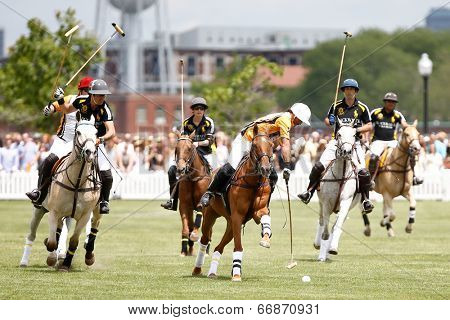 JERSEY CITY, NJ-MAY 31: Marcos Garcia del Rio (C) in action during the polo match at the 7th Annual Veuve Cliquot Polo Classic at Liberty State Park on May 31, 2014 in Jersey City, NJ.